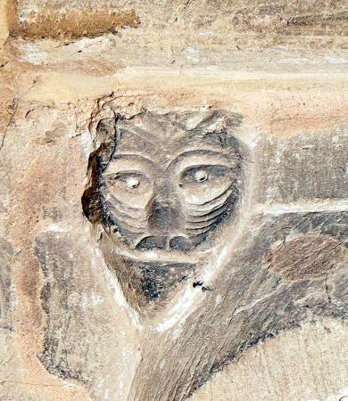 Beak-head carving on chancel arch