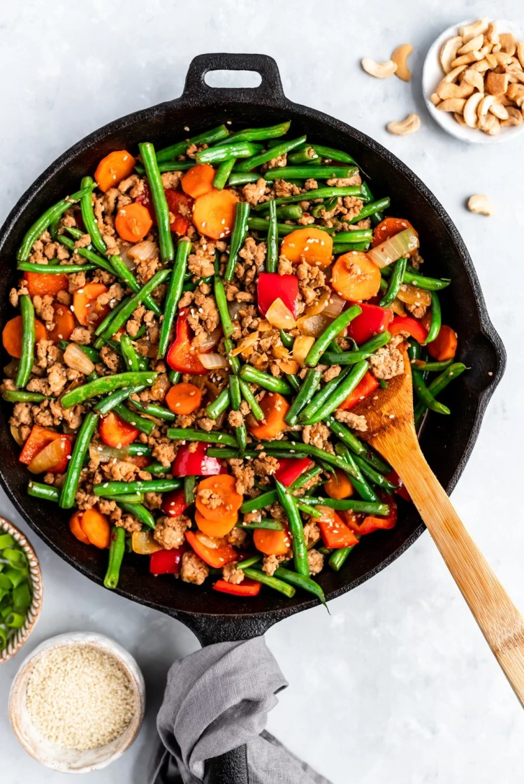 healthy chicken and green bean stir fry in a pan