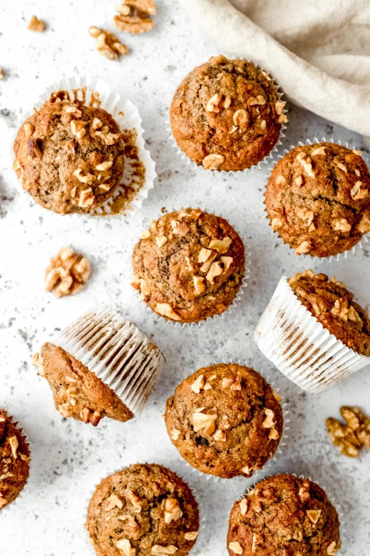 healthy banana muffins topped with walnuts