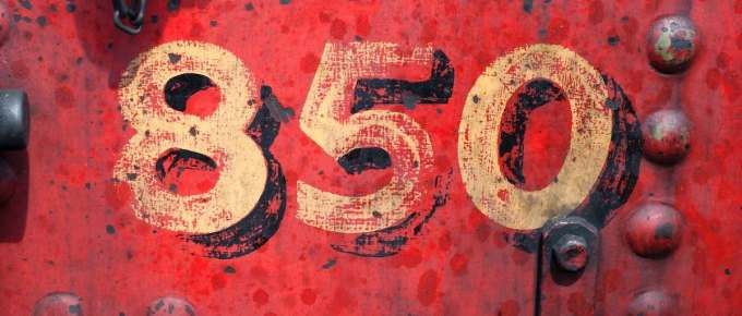 The number 850 on a red painted background