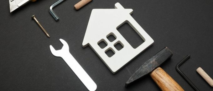Image of a home, with tools all around it