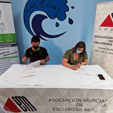Firma convenio ENMOVE y AMDEM