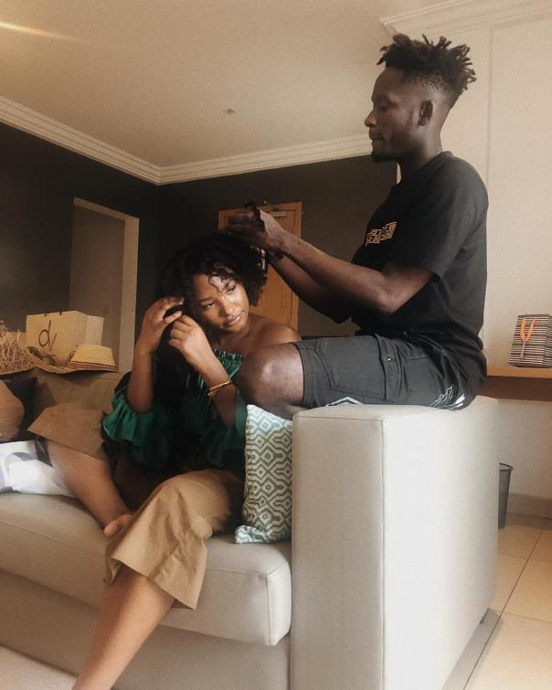 Mr Eazi shared a loved up photo in which he was making Temi's hair (2)