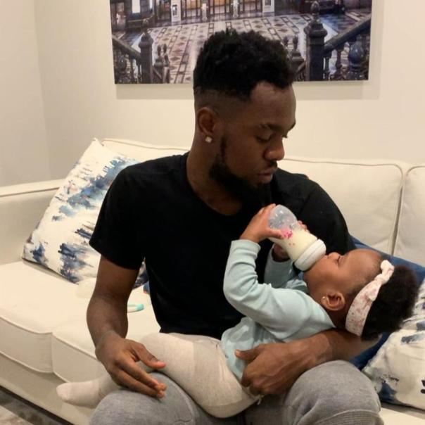 Patoranking Bottle-feeding His Daughter