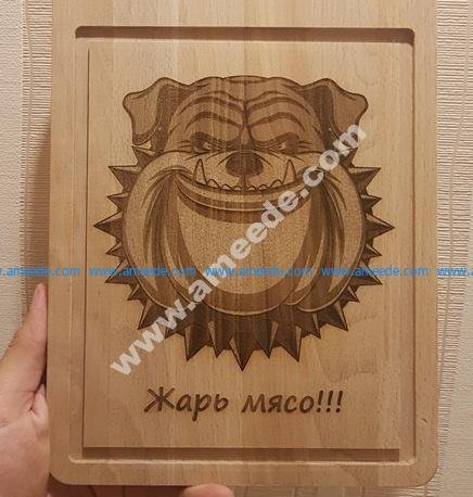 the cutting board engraved the face of a sloppy dog