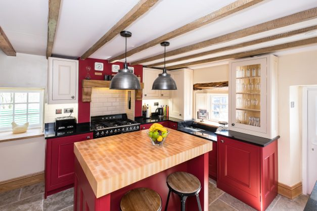 Bold rustic kitchen with industrial elements designed by Amelia Wilson Interiors Ltd