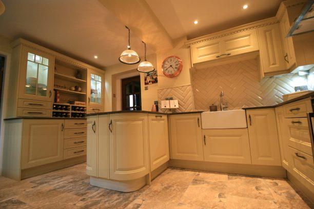 Cream shaker style kitchen by Amelia Wilson Interiors Ltd