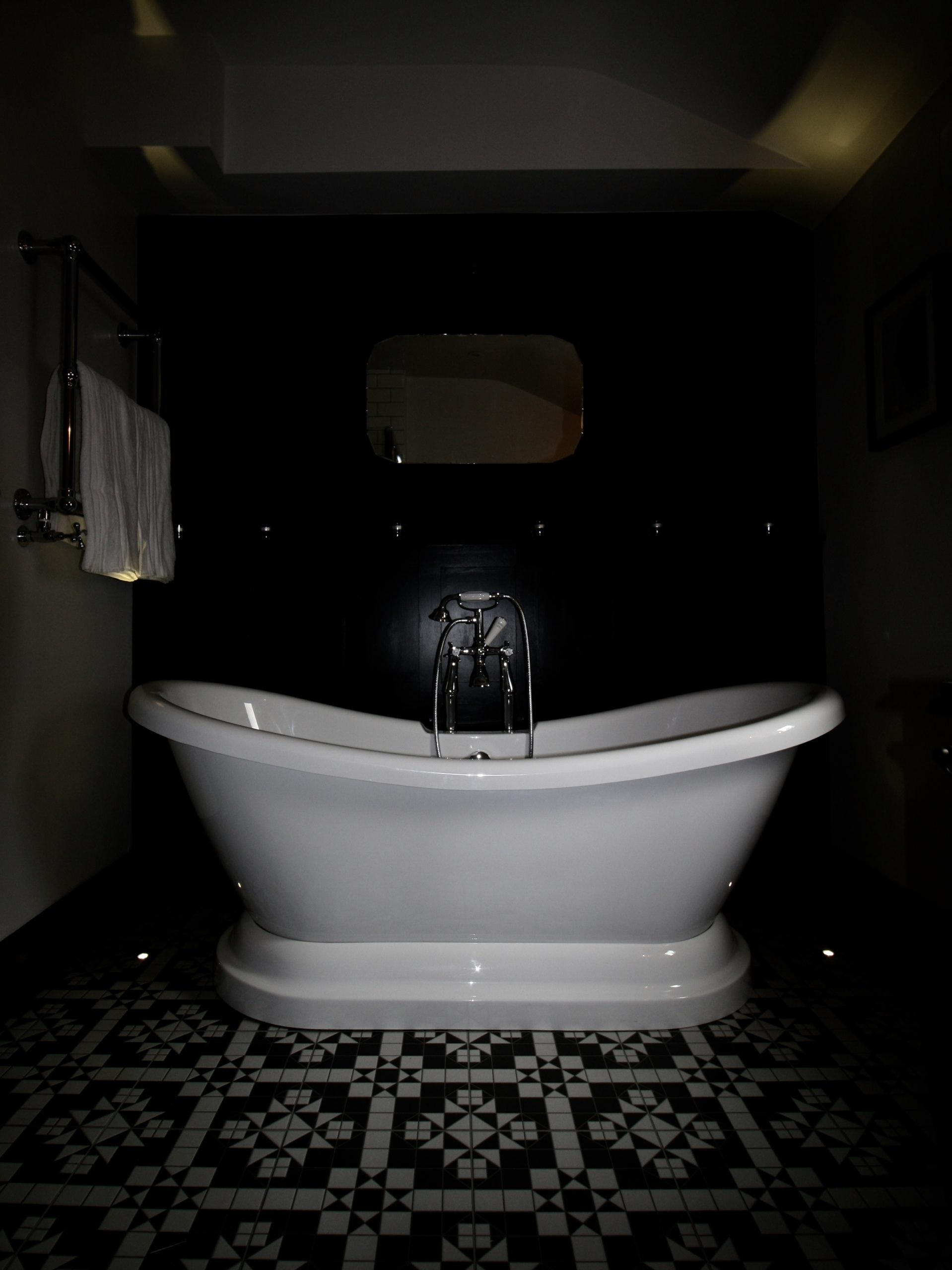 Deck lights used in a bathroom to light a free standing bath from below