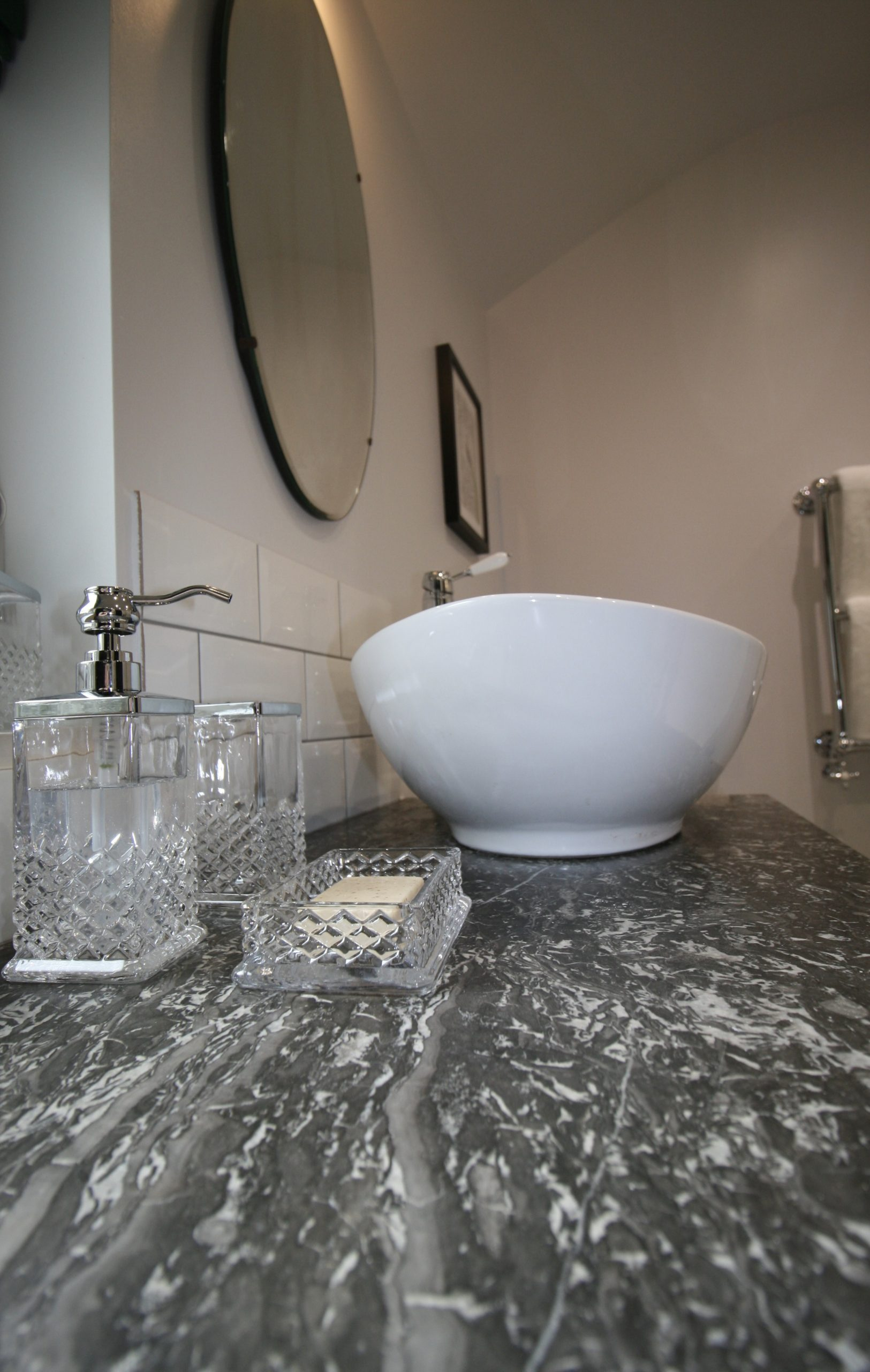 Bathroom - Grey marble topped antique washstand with oval sink, traditional taps and cut glass accessories