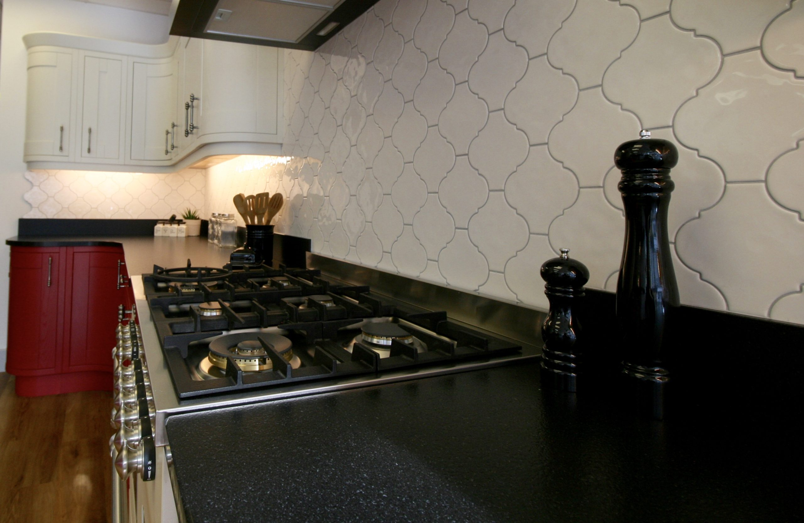 Moroccan style Quintessential cream tiles from Topps with pale grey grout and black Moak granite from the new Sensa range by Cosentino