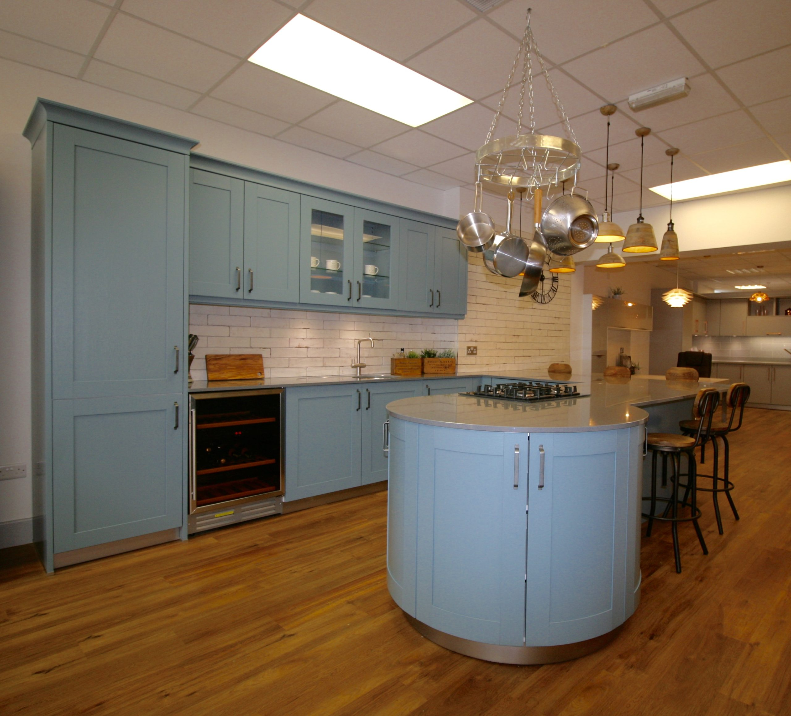 Schuller Casa shaker style kitchen in blue-grey with polished steel effect silestone worktop, and industrial and vintage tiling and accessories