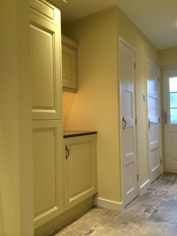 Zoned utility area in kitchen for toilet, boiler cupboard and washer/dryer
