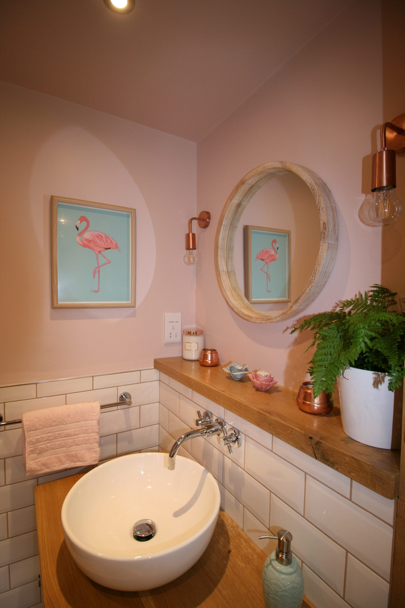 Bathrooms - Flamingo print and copper lights in bathroom designed by Amelia Wilson Interiors
