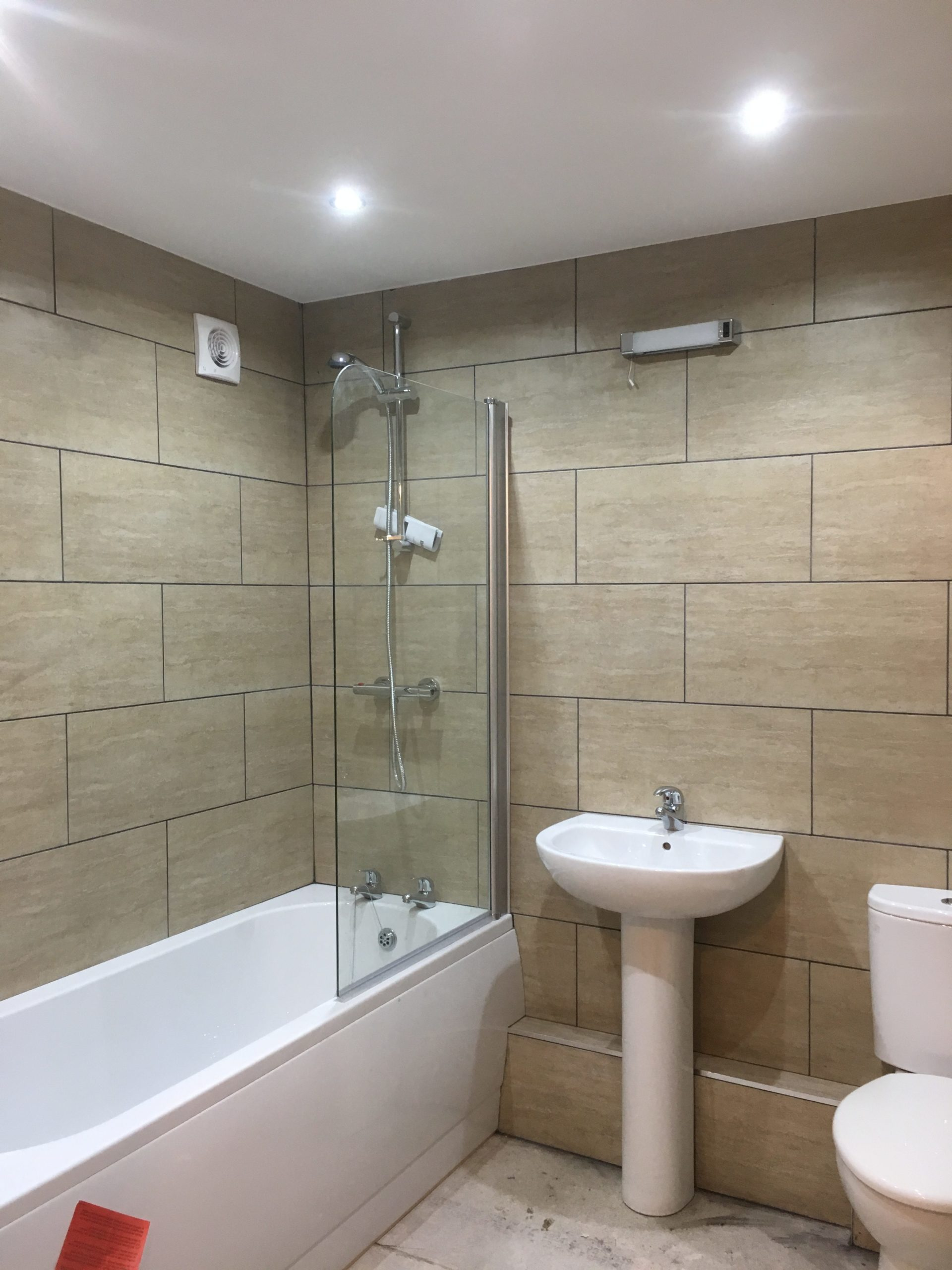 Before image of bathroom in show home designed by Amelia Wilson Interiors Ltd