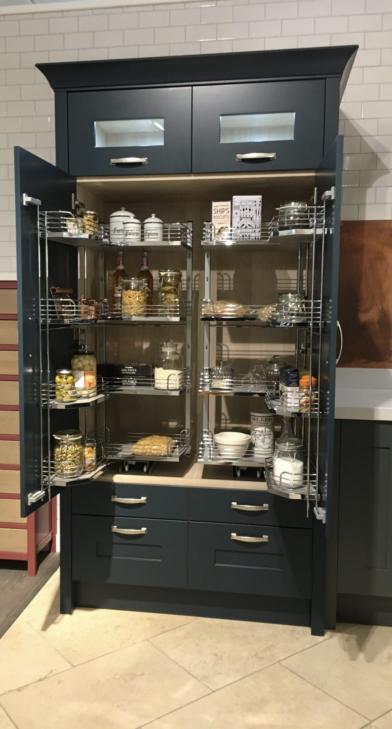 A traditional larder with more practical pull out shelving