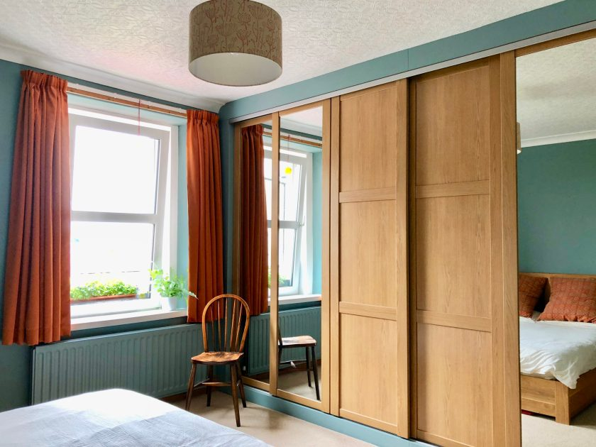 Custom built wardrobes in bedroom designed by Amelia Wilson Interiors Ltd