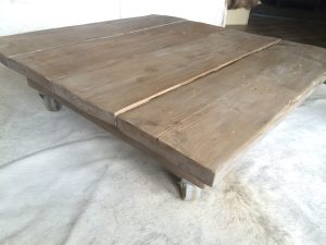 Scaffolding plank coffee table and cow hide rug