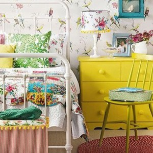 Yellow chest of drawers in vintage bedroom