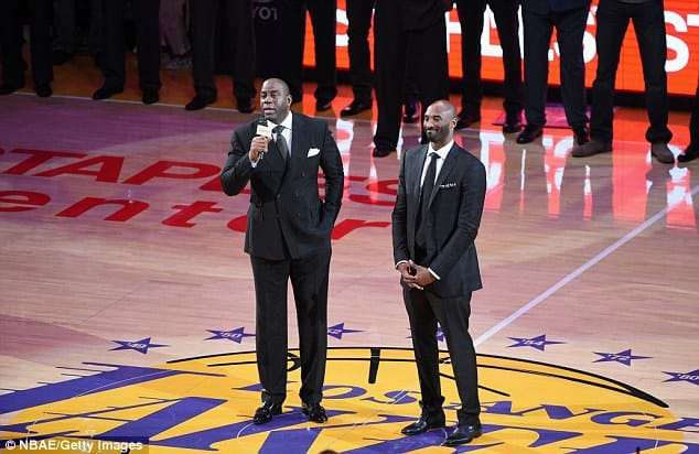 Magic Johnson addresses the Staples Center spectators as Kobe Bryant stands proudly [www.AmenRadio.net]