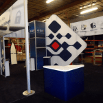 segue island exhibit stand with silicone edge graphics closet storage and creative trade show signs-resized-600