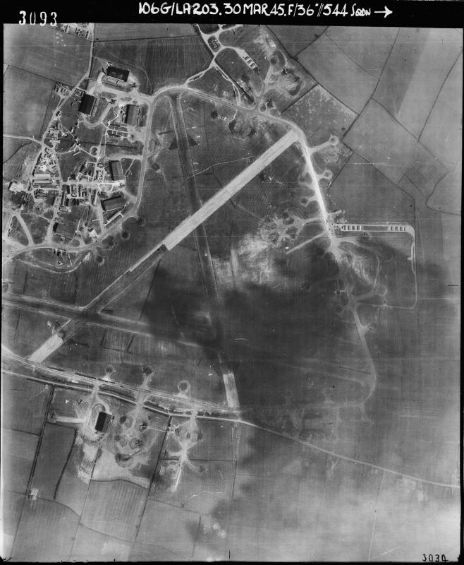 Aerial photograph of Bottesford airfield looking east, the technical site with seven T2 hangars, control tower and airfield code are top left, the bomb dump is on the right, 30 May 1945. Photograph taken by No. 544 Squadron, sortie number RAF/106G/LA/203. English Heritage (RAF Photography).