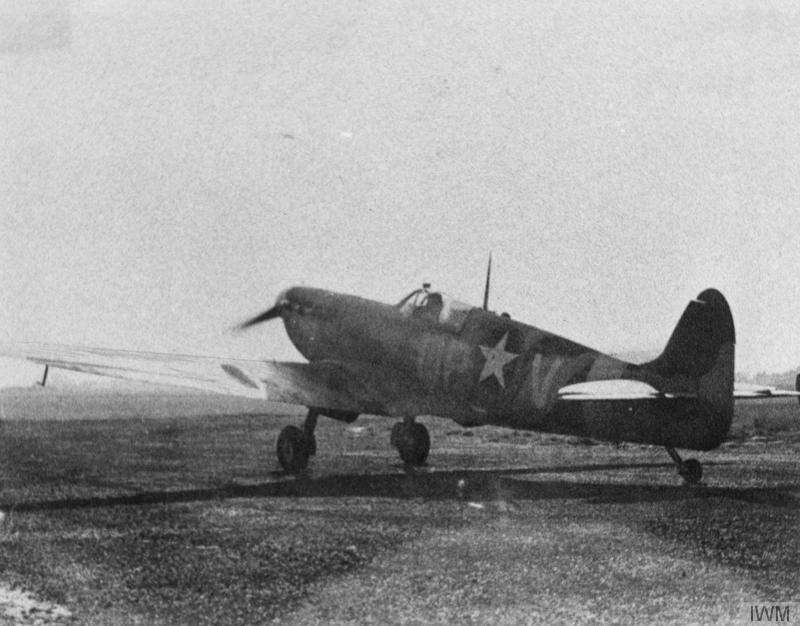 A Spitfire Mk. V (QP-V) of the 334th Fighter Squadron, 4th Fighter Group. Handwritten caption on reverse: '1942. 334 FS. 4th FG.'