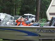 Timothy & friend in boat ready for fishing, with Darold watching