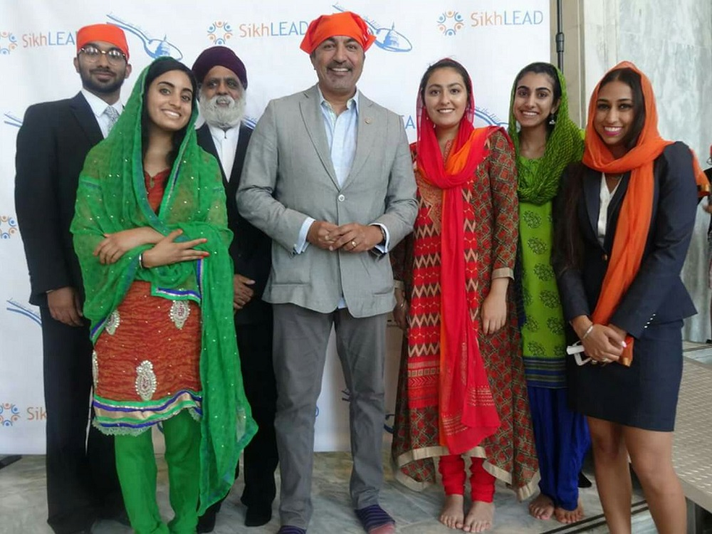 Rep. Ami Bera is flanked by SikhLEAD interns and leaders of SALDEF at the fourth annual Langar on Capitol Hill on July 24, 2017.