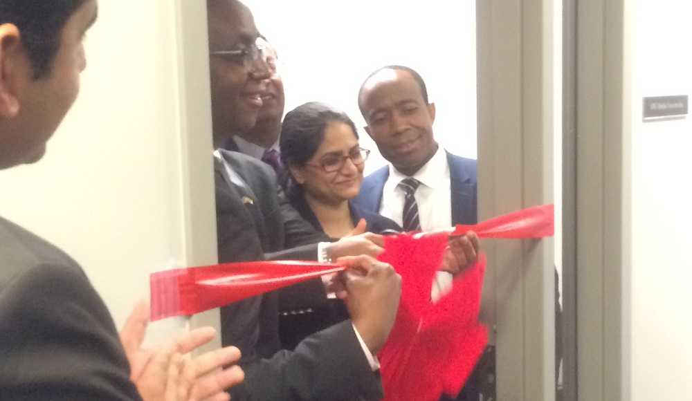 An executive of MIG Media Neurons cutting ribbon to open its new office at Prince George County's India Business Center in Largo, MD, on August 10, 2017. American Bazaar Photo