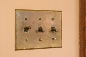 AMONG THE BUNGALOW'S MANY ORIGINAL DETAILS ARE BRASS LIGHT SWITCHES AND PLATES