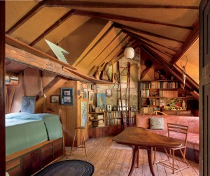 Wharton Esherick's bedroom remains today much as it was during the time that he lived here. Among the many works of art that can be found in the room are, from left, his Two -Pos ter Bed (1928), Speed (1932), and Stool (ca. 1965). His Writing Table from 1956 and the Bok Sofa from 1936 fill out the room.