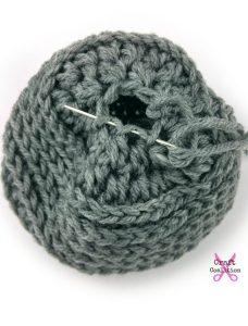 My Dolly Edgy Messy Bun Hat | Crochet Pattern | American Crochet @americancrochet.com #crochetpattern