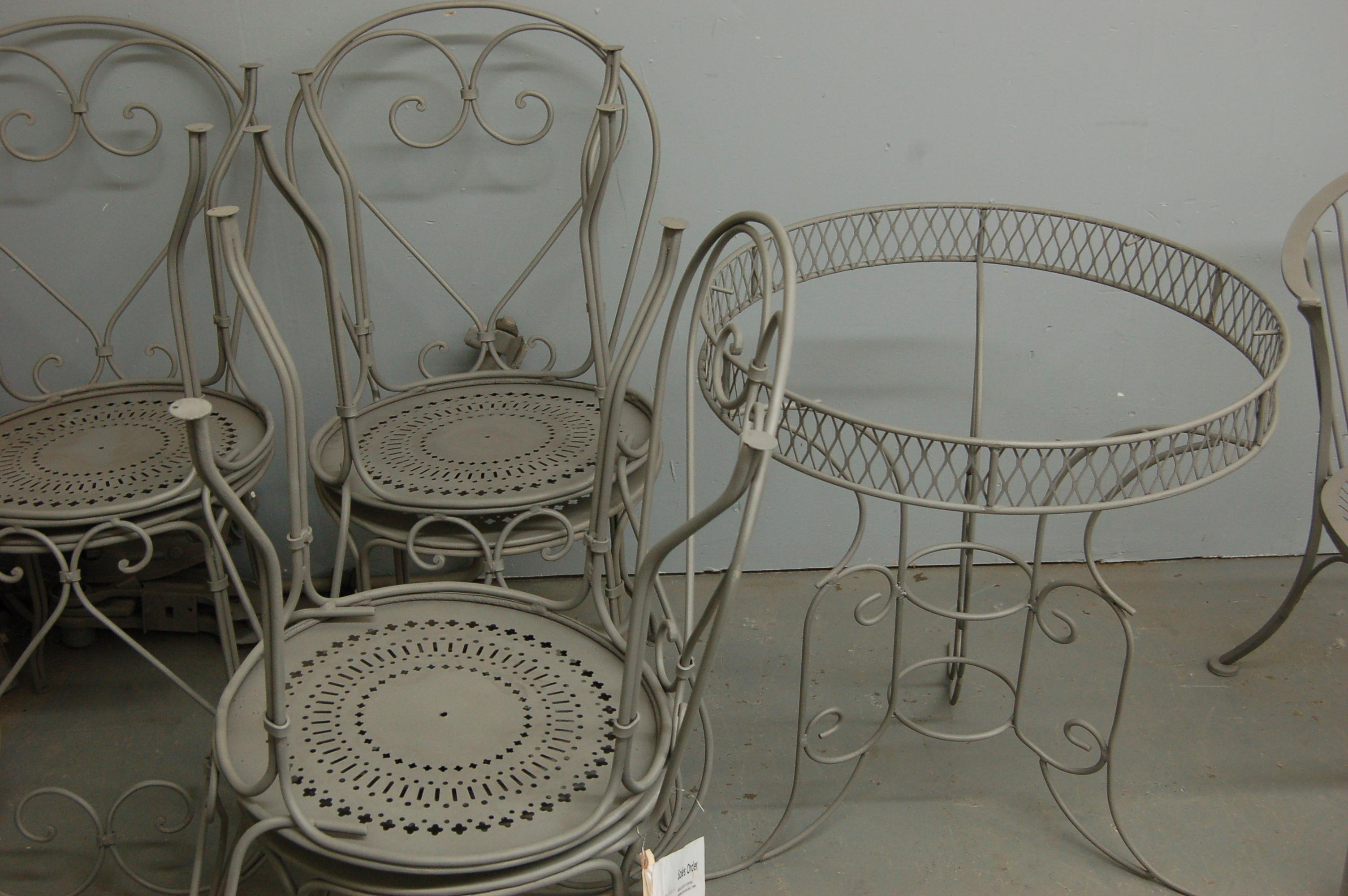Stripped metal patio furniture awaiting powder coating