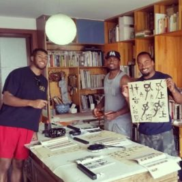 Image 15 – (left to right) Darien, Vladimir _ Floyd at Calligraphy lessons