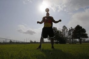 FILE - In this Dec. 16, 2015, file photo, New Orleans Saints outside linebacker Kasim Edebali plays with a soccer ball in Metairie, La. Edebali parlayed his American high school experience into a scholarship at Boston College, then signed with New Orleans as an undrafted free agent in 2014. (AP Photo/Gerald Herbert, File)