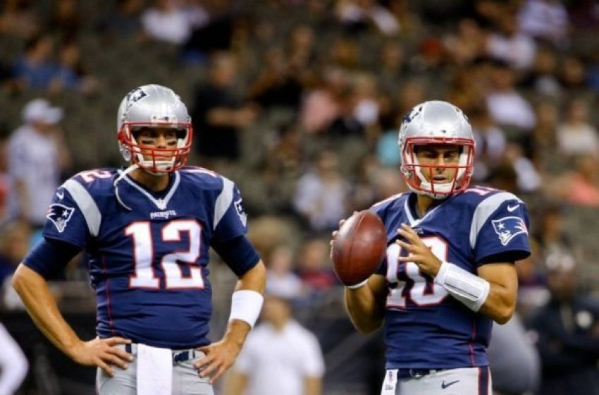 Aug 22, 2015; New Orleans, LA, USA; New England Patriots quarterback Tom Brady (12) and quarterback Jimmy Garoppolo (10) prior to a preseason game against the New Orleans Saints the at Mercedes-Benz Superdome. Mandatory Credit: Derick E. Hingle-USA TODAY Sports