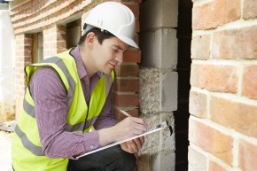 a home inspector - American Home Services