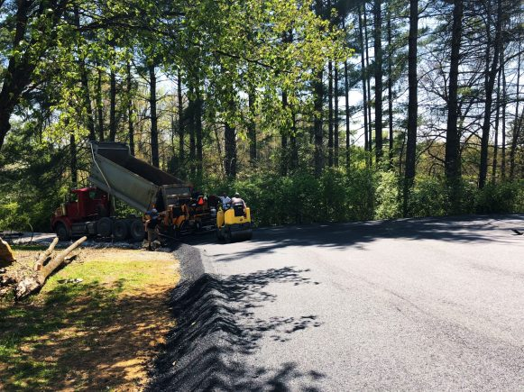 Installation of New Asphalt Driveway With Water Directional Berm