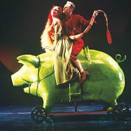 """Peer Gynt,"" Shakespeare Theatre Company, 1998, production photograph. The Lady in Green rode to the Troll Kingdom on a green pig, an idea that came from a pink pig Adrianne Lobel had designed as a student at Yale. This pig was modeled on Lee's granddaughter's piggy bank."