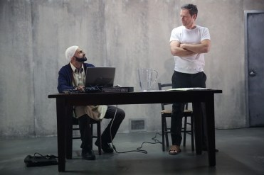"""The Invisible Hand"" by Ayad Akhtar, at New York Theatre Workshop in New York City through Jan. 4. Pictured: Usman Ally and Justin Kirk. (Photo by Joan Marcus)"