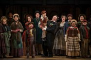 """A Christmas Carol"" adapted by Joseph Hanreddy and Edward Morgan from Dickens, at Milwaukee Repertory Theater through Dec. 24. Pictured: Amalia Cecsarini and Jonathan Smoots, center, with the cast. (Photo by Michael Brosilow)"