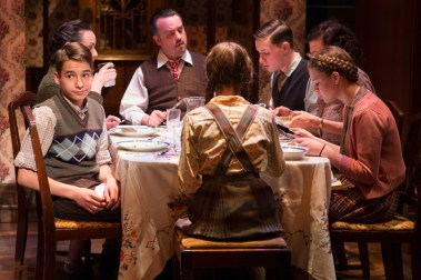"""Brighton Beach Memoirs"" by Neil Simon, at Theater J in Washington, D.C., through May 7. Pictured: Cole Sitilides, Susan Rome, Michael Glenn, Eli Pendry, Lise Bruneau, Marie-Josée Bourelly, and Sarah Kathryn Makl. (Photo by Teresa Wood)"