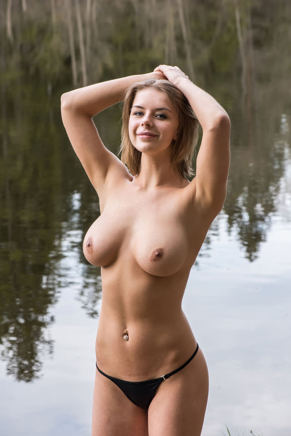 Shorthaired and naturally busty brunette posing in the