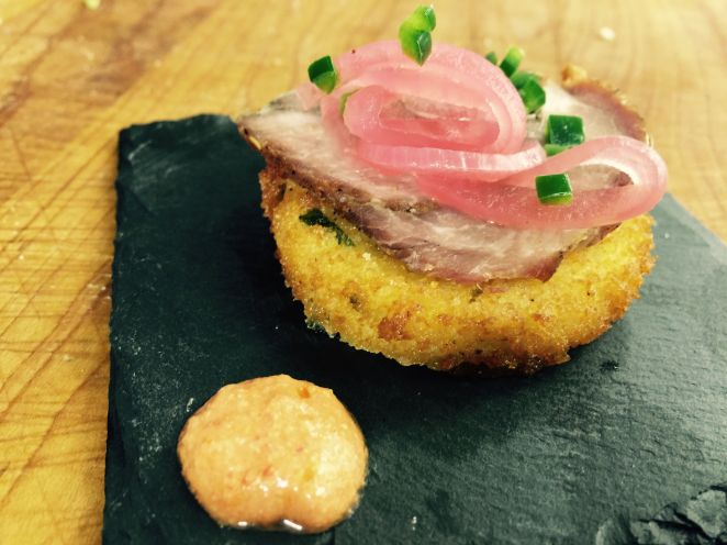 Fried Polenta Rounds Topped with Porchetta and Pickled Red Onions