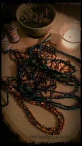 Imbolc candle and knotwork spells