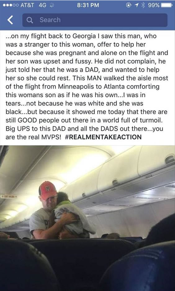Man walking back and forth on plane, comforting a seat mate's baby for her.