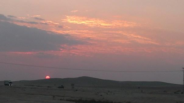 The sun setting in the Negev desert