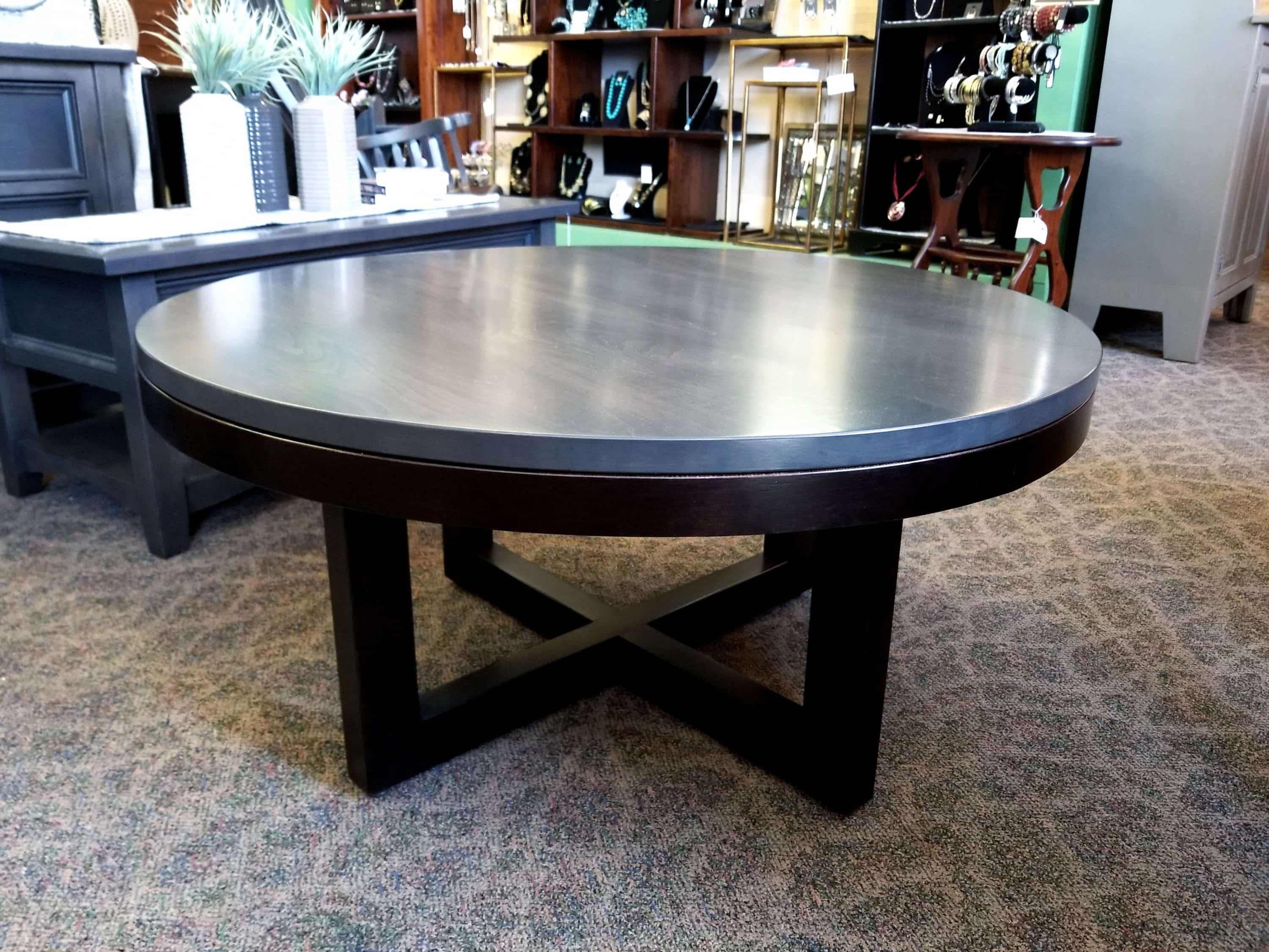 xcell round coffee table shown in brown maple with a two tone onyx base and a st grey top