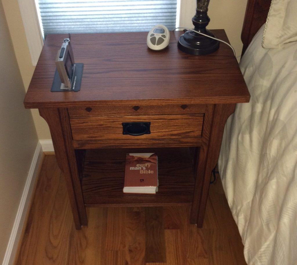 Solid Oak Nightstand Graces A Comfortable Bedroom