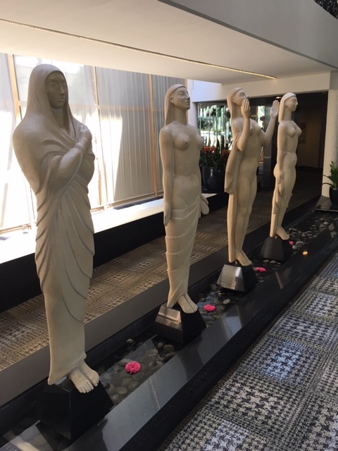 Statues welcoming you to the lobby of White Oaks
